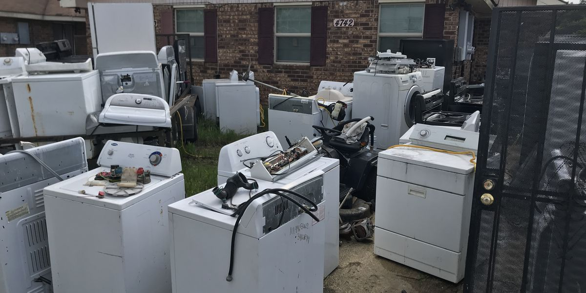 FOX 8 DEFENDERS: Appliances strewn across lawn frustrate neighbors who say homeowner was previously cited