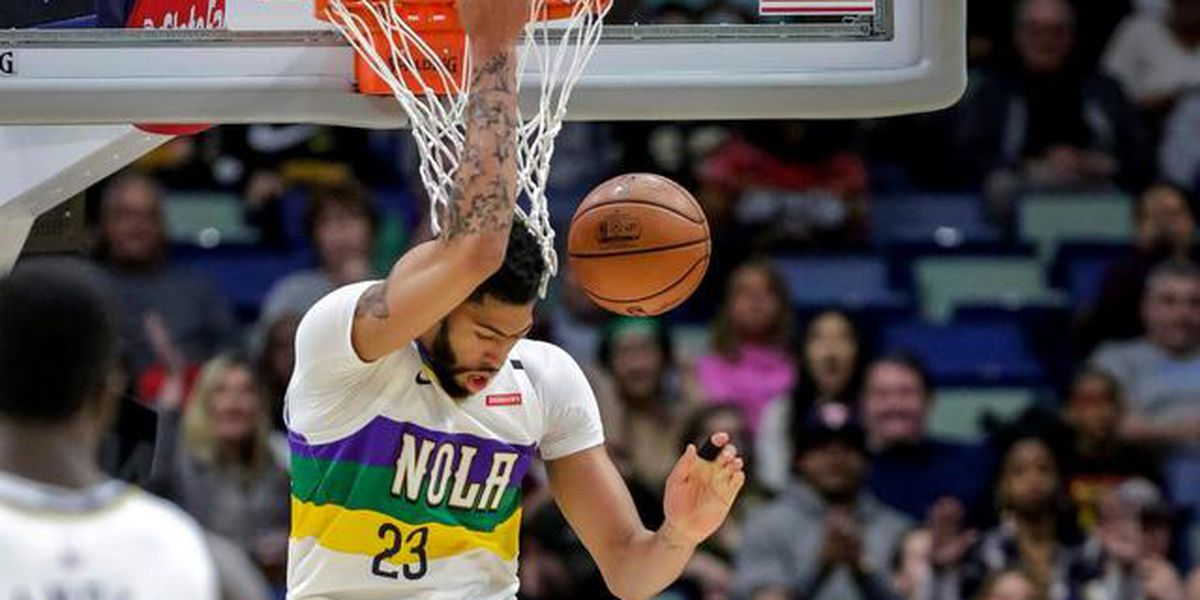 Untraded Davis scores 32 points, Pelicans beat Wolves, 122-117