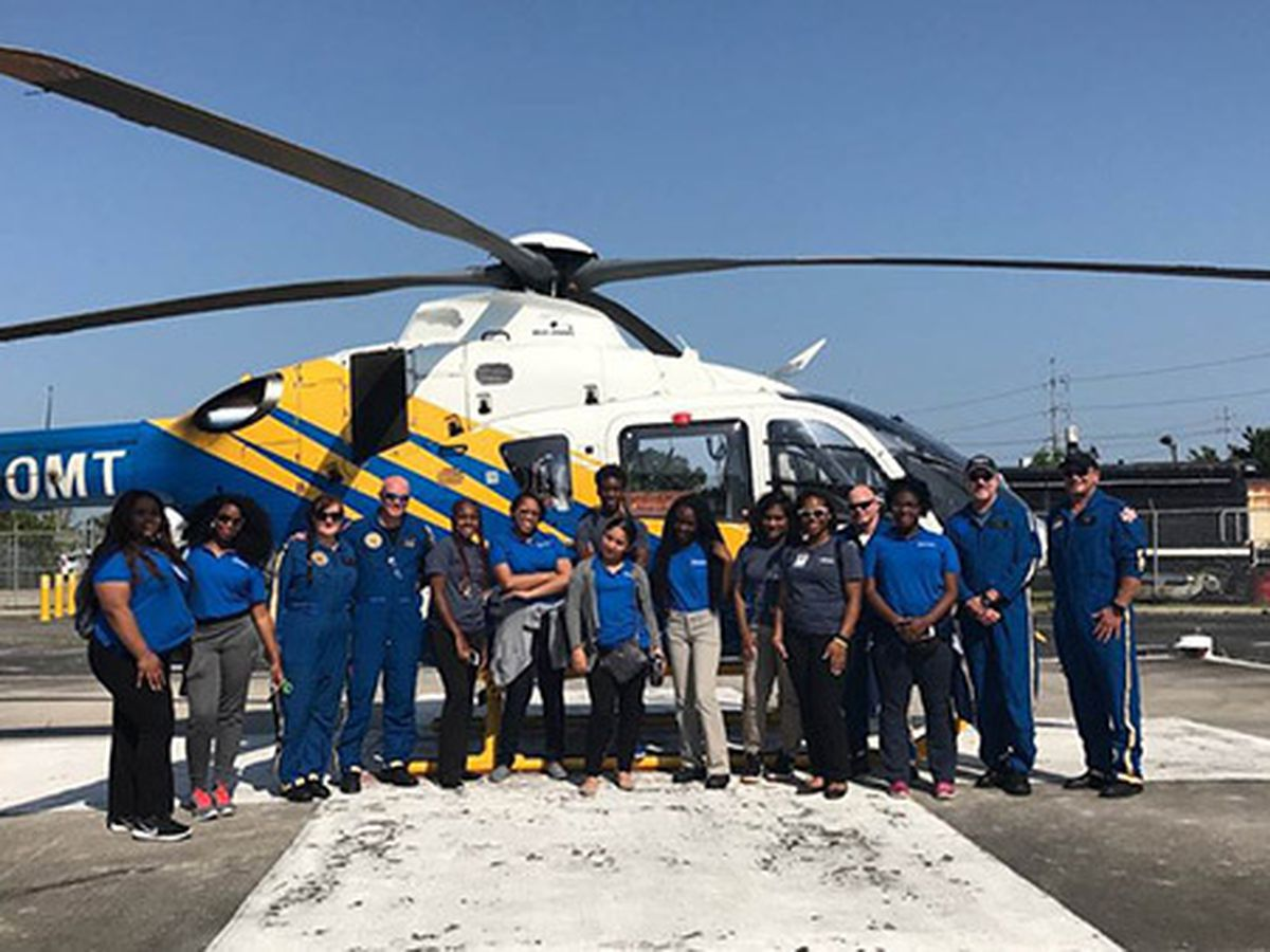 Summer campers tour Ochsner helicopter Tuesday