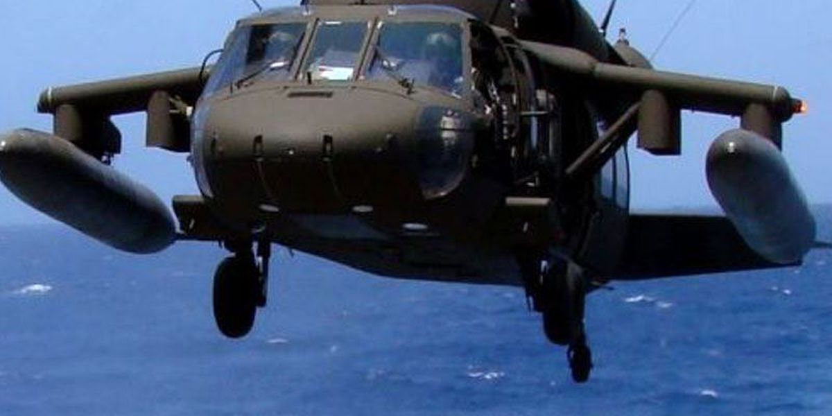 Weather suspends search for 11 service members missing in crash