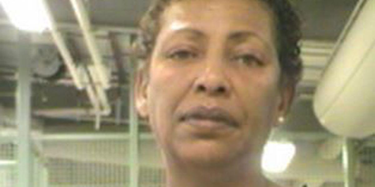Woman identified in alleged bleach attack; police seek son
